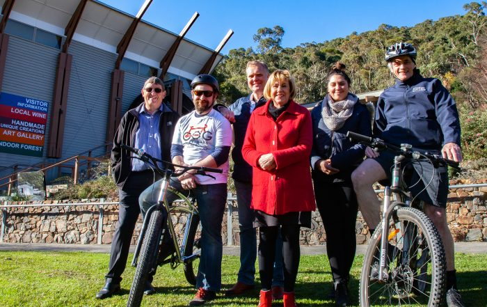 Warburton Funding Announcement. Rodney McKail (Chair, Warburton & Yarra Junction Community Bank Branches), Joel Warham (on bike, Cog Bike Cafe), Tony Smith MP, Peta Godenzi (CEDA), Simone Senton-Jonker (BT Dubs Cafe) and Cr Jim Child in Warburton