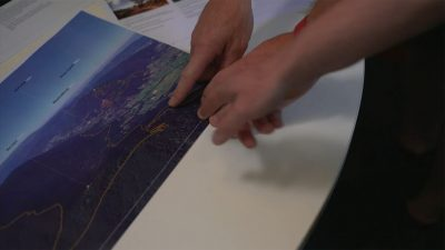 People pointing at map of proposed Warburton Mountain Bike Destination trail alignments